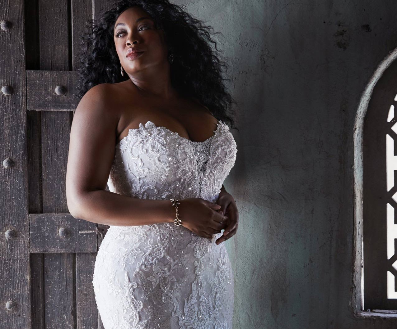 Plus size model wearing a white gown